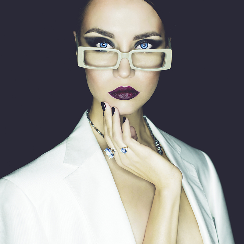 Fashion Studio Portrait Of Beautiful Woman With Glasses
